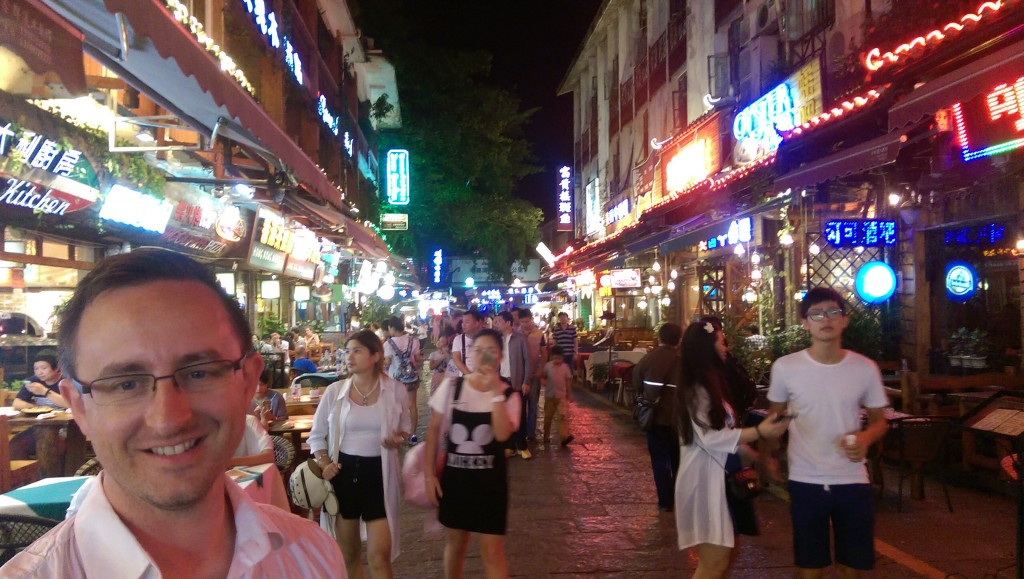 Will on West Street in Yangshuo, a busy street full of bars and restaurants